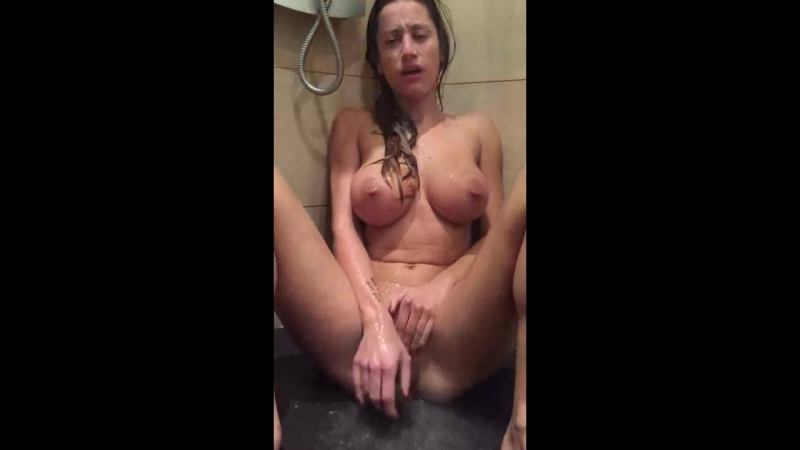 Busty milf with big tits masturbating at shower
